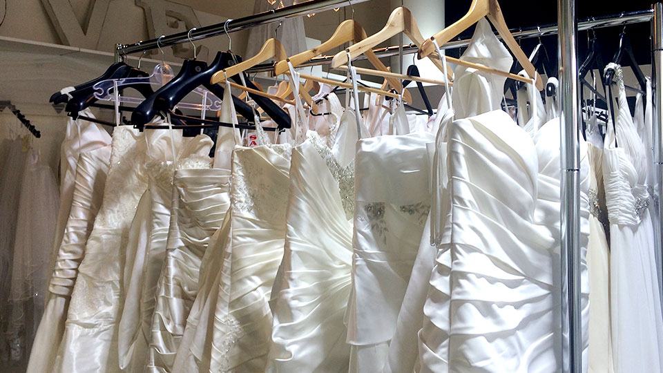 Dresses on rack - Eternal Weddings